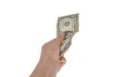 Één die dollar in de hand op witte achtergrond wordt geïsoleerd Stock Foto's