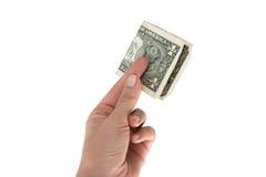 Één die dollar in de hand op witte achtergrond wordt geïsoleerd Royalty-vrije Stock Fotografie