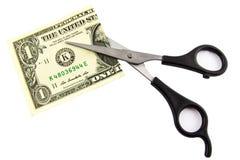 Één die dollar in de helft met schaar wordt gesneden stock foto's