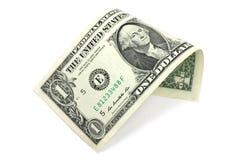 Één die dollarrekening in een buis wordt gevouwen Stock Foto's