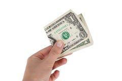 Één dollar in de hand Stock Foto's
