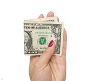Één dollar in de hand van het meisje op een witte achtergrond Stock Foto