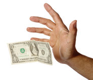 Één dollar die van een menselijke hand valt Royalty-vrije Stock Afbeeldingen
