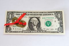 Één dollar en Chinees muntstuk op een wit Stock Foto