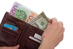 Één dollar en portefeuille met euro bankbiljetten Stock Foto