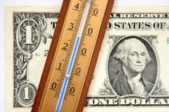Één dollar en thermometer Stock Foto