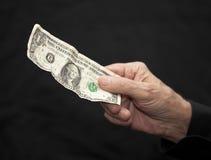 Één Dollar in oude hand Royalty-vrije Stock Foto