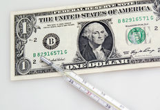 Één dollarbankbiljet en thermometer Royalty-vrije Stock Afbeelding