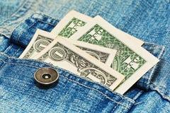 Één dollarnota's in de zak van het jeansjasje royalty-vrije stock afbeeldingen