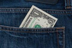 Één dollarrekening in de zak stock foto
