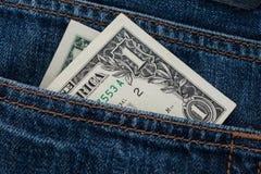 Één dollarrekening in de zak royalty-vrije stock foto's
