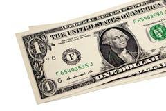 Één Dollarrekeningen op witte achtergrond stock foto's