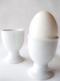 Één ei - twee eierdopjes Stock Foto