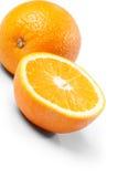 Één en halve sinaasappelen Stock Foto's