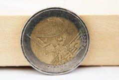 Één Euro muntstuk op wit Stock Foto