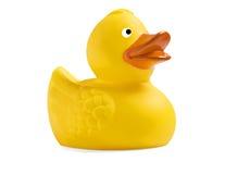 Één geel stuk speelgoed eendje op witte achtergrond Royalty-vrije Stock Afbeeldingen