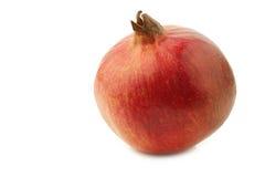 één gehele pomegranate& x28; Punica granatum & x29; Stock Foto