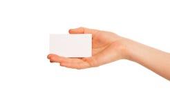 Één hand die een wit stuk van karton houden Stock Afbeelding