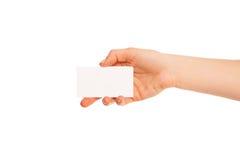 Één hand die een wit stuk van karton houden Stock Fotografie