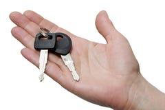 Één hand met sleutels stock foto