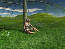 Één jong meisje zit onder een boom Royalty-vrije Stock Afbeelding