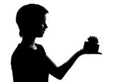 Één jong tienerjongen of meisje die huidig giftsilhouet aanbieden Stock Fotografie