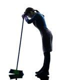 Het meisjehuishoudelijk werk vermoeid brooming silhouet van de vrouw royalty-vrije stock foto