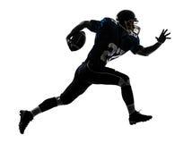 het Amerikaanse lopende silhouet van de voetbalstermens Stock Foto's