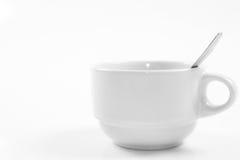 Één Kop van koffie en de lepel van de Koffie Stock Afbeelding