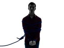 Één opgesloten mens catched het silhouet van de lassogevangene Stock Afbeeldingen