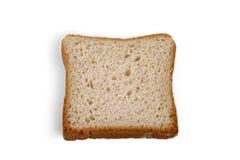 Één plak van wit brood op een lichte achtergrond royalty-vrije stock fotografie