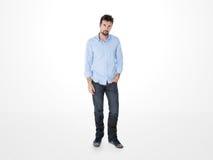 Één resolute kerel met het blauwe overhemd stellen Stock Foto