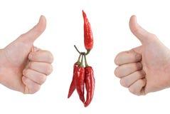Één roodgloeiende peper heft peper drie op Stock Fotografie