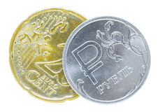 Één Russische roebel en 20 eurocenten Stock Fotografie