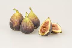 Één sneed fig. en drie gehele fig. Royalty-vrije Stock Afbeeldingen
