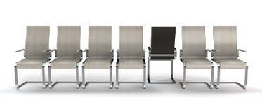 Één stoel die uit lijn stappen Royalty-vrije Stock Afbeeldingen