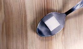 Één Sugar Cube op een Zilveren Lepel Royalty-vrije Stock Foto
