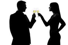 Één van de paarman en vrouw het drinken champagne Stock Afbeelding