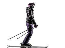 Één vrouwenskiër het ski?en silhouet stock fotografie