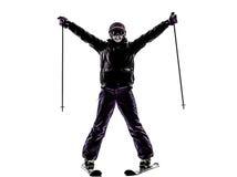 Één vrouwenskiër het ski?en wapens uitgestrekt gelukkig silhouet Royalty-vrije Stock Afbeeldingen