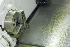 防锈通过涂上cnc工业车床纺锤或部分把柄的油膏  库存照片
