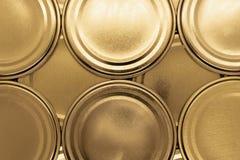 金黄瓶子盒盖背景 免版税库存照片