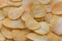 酥脆土豆片快餐纹理背景 免版税图库摄影