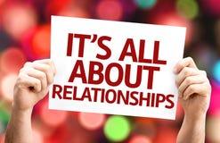 É toda sobre o cartão dos relacionamentos com fundo colorido com luzes defocused Fotos de Stock
