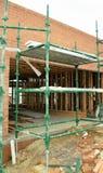 Échafaudage au chantier de bâtiment Photo libre de droits