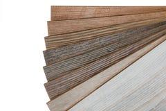 Échantillons de plancher en stratifié d'isolement sur le fond blanc photographie stock