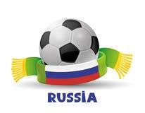 Écharpe et ballon de football verts Photos stock