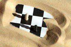Échecs en sable Photographie stock