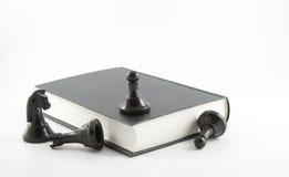 Échecs et livre Images libres de droits