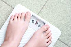 Échelle de poids Photos stock